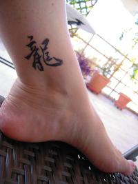 testimonials grass style tattoo cursive script